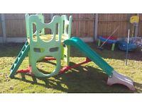 Childrens slide with climbing platform