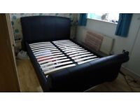 Bensons for Beds - Double brown faux leather bed.
