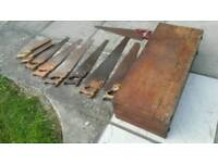 Collection of Vintage hand saws in vintage tool chest