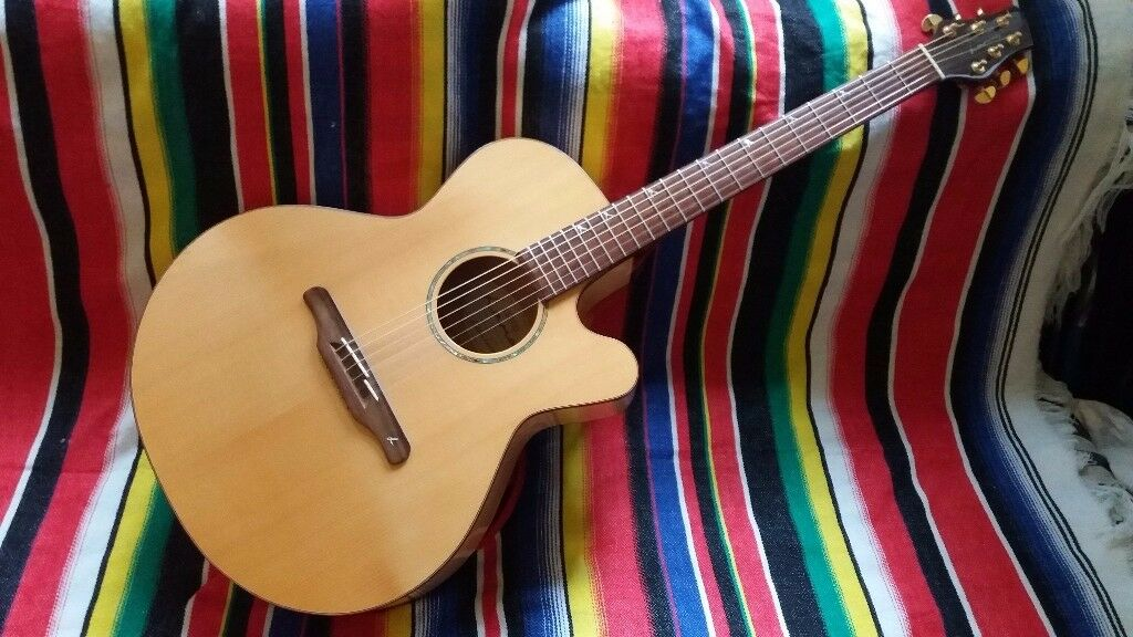 LAMAQ electro acoustic guitar in maple with spruce top, Fishman pickup/tuner and grovers.