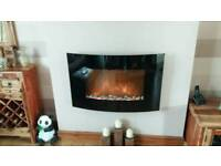 Wall hung bow front electric fire