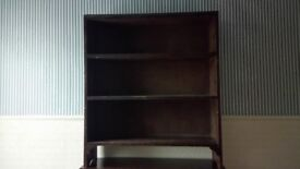 Old stained pine shelving unit.