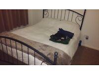 Kingsize metal framed bed