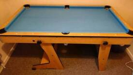 5ft snooker table with blue baize and selection of cues