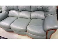 Green 3 seater leather sofa with electric recliner - good condition