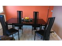 harvey's black glass table with 4 chairs