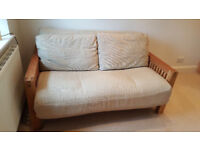 Two seat solid oak futon by Futon Company, 'OKE' range with three fold mattress, pillows and cover