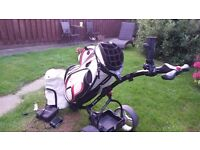 MOTOCADDY SI TROLLEY WITH 18 HOLE BATTERY PLUS USED POWAKADDY RED/WHITE BAG