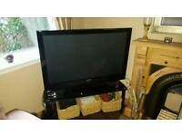 "Samsung 50"" HD Plasma TV and black glass TV stand"