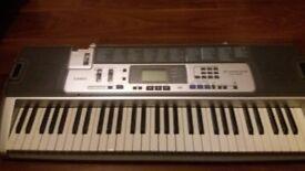 Casio keyboard LK100 light up learning keyboard. 61 keys.