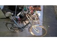 "Hercules folding bike. 3 speed, 16"" wheels,stand, rear rack, basket holder, paint condition poor"