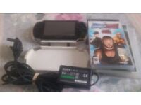 PSP CONSOLE IN GOOD QUALITY WHITE CASE WITH GENUINE CHARGER AND THREE GAMES FOR SALE