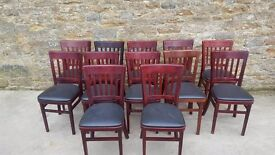 black trimed red wood chairs