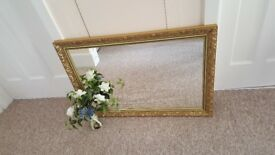 Mirror with a beautiful gold coloured ornate frame in great condition
