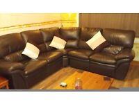 5 seater dark brown leather corner sofa.
