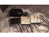 Black Nintendo DS lite with case and two games