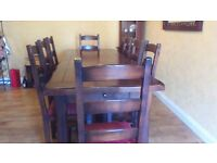 solid dark wood dining room table (Extends twice) with Eight matching dining