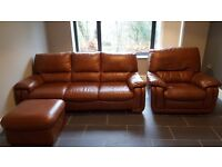 Light brown real leather three seater sofa, reclining armchair and foot stool.