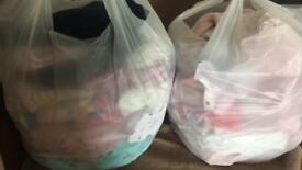 2 bags of 0-3 month baby clothes