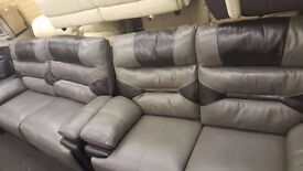 Real leather 3+2 seater sofa.3 seater is Electric reclining and 2 seater manual reclining grey/black