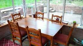 dining room furniture: java rustic dining table & 6 chairs with fitted cushions. good condition.