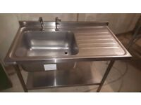 Commercial stainless steel sink with upstand. Complete with stand & shelf. Used - 120cm X 65cm
