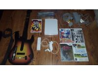 Nintendo Wii - Fully working + greats games, guitar hero and more