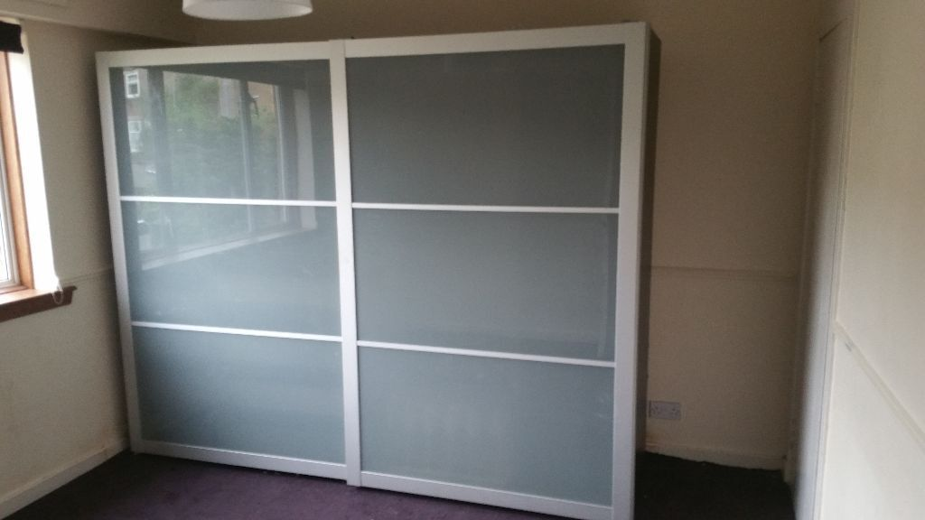 Ikea pax wardrobes frosted glass sliding doors sliding for Ikea glass sliding doors