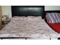 Metal double size bed. Good quality. Headboard also available. Need gone asap. New bed here