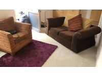 Brown 2 seater sofa and striped armchair