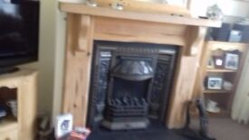 Solid pine fire surround and cadt iron inset