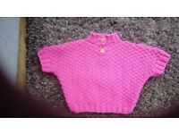 Beautiful hand knitted little girls poncho style jumper