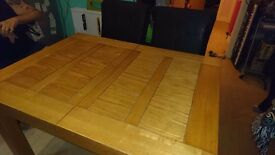 Solid oak extending table with 4 chairs