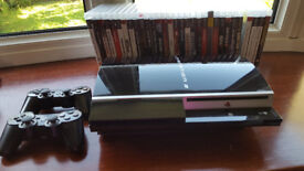 500gb PS3 console, 2 controllers and 31 games