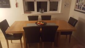 Solid Oak Table and 6 chairs.