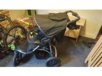Pushchair with footmuff and raincover