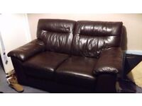 2 seater brown leather sofa with foot stool. Very comfortable. Selling due to moving house.