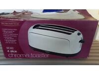 BRAND NEW CHROME 4 SLICE TOASTER. NEVER BEEN USED, BOX HAS SLIGHT DAMAGE.