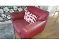 NATUZZI Red leather armchair