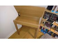 Wooden desk and black chair