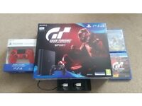 PS4 slim 500GB + 2 controllers, dual charger and games.