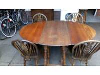 Table and four chairs solid oak £45