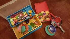 A large bundle of toy kitchen accessories