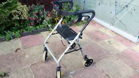 Walking aid with brakes and seat Rollator