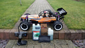 1/5th scale radio controlled 26cc buggy