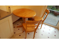 Lovely round kitchen table and three chairs