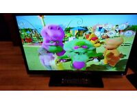 "32"" Technika led tv,SLIM LINE,freeview ,3x hdmi,DVBT,etc.less than 1 year old,remote control &stand"