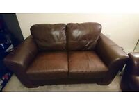 2 X 2 seater brown leather sofas for sale.