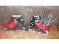Red and black inline roller skates sizes 5-7
