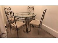 glass top dinning table with 4 chairs - good condition. couple of minor stains on chairs in photos.